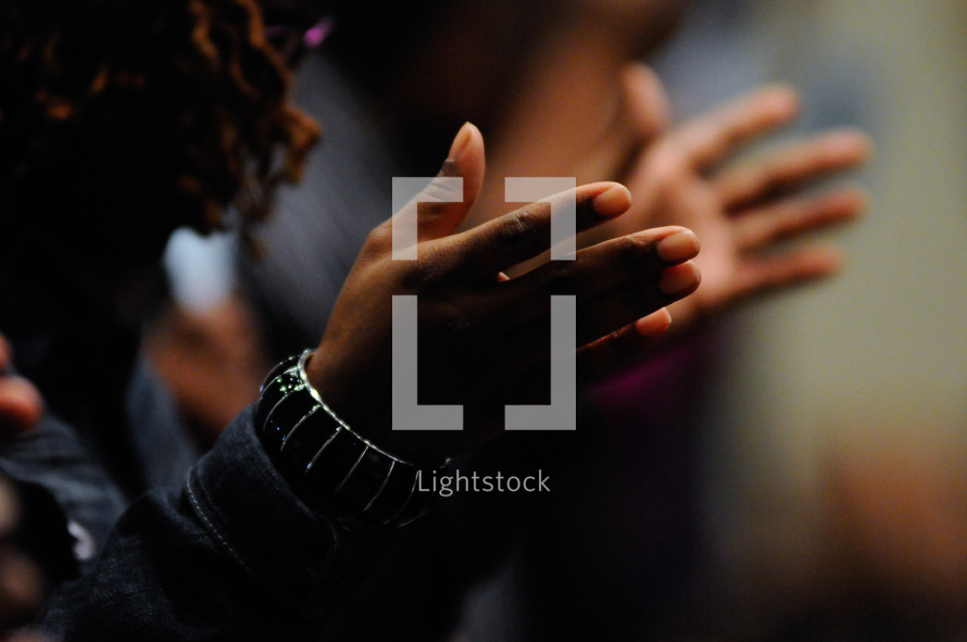 hands in worship at church