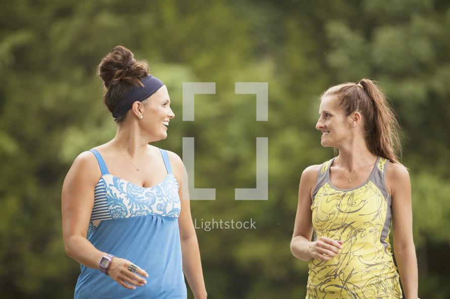 women talking while on a walk