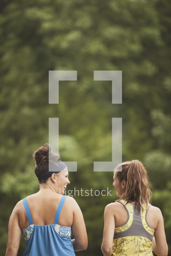 women talking and walking