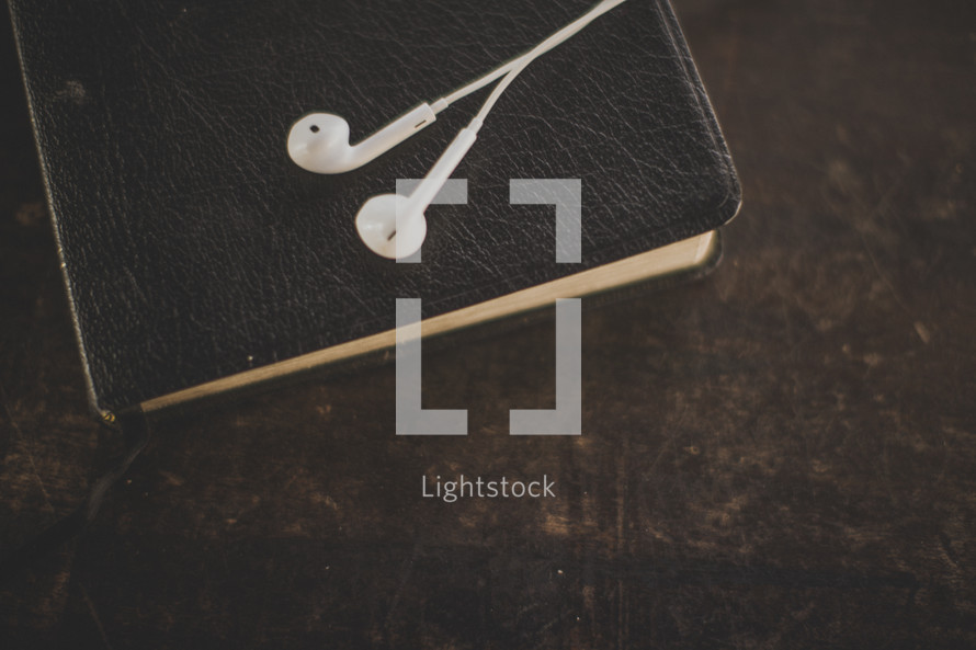 Ear buds on a Bible