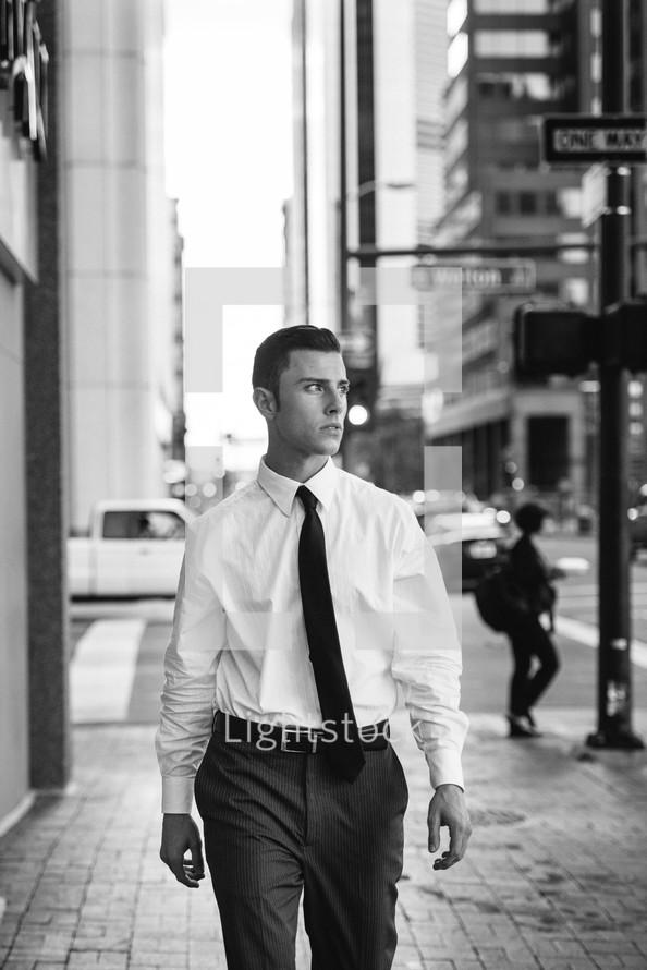 business man walking down a sidewalk