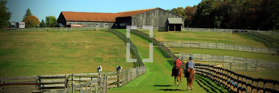 riding horses on a horse farm