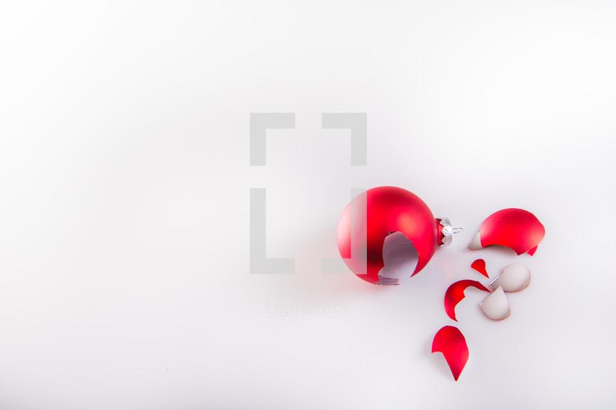 broken red Christmas ornament