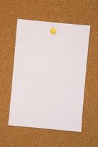 blank paper on a cork board