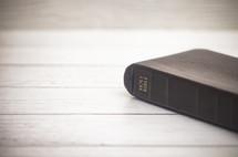 Holy Bible on white wood background