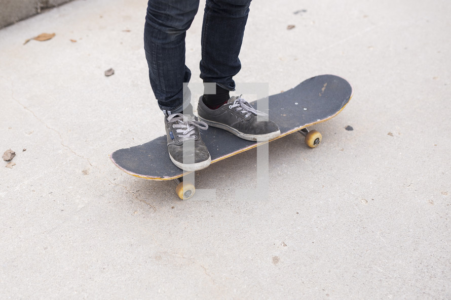 a man standing on a skateboard