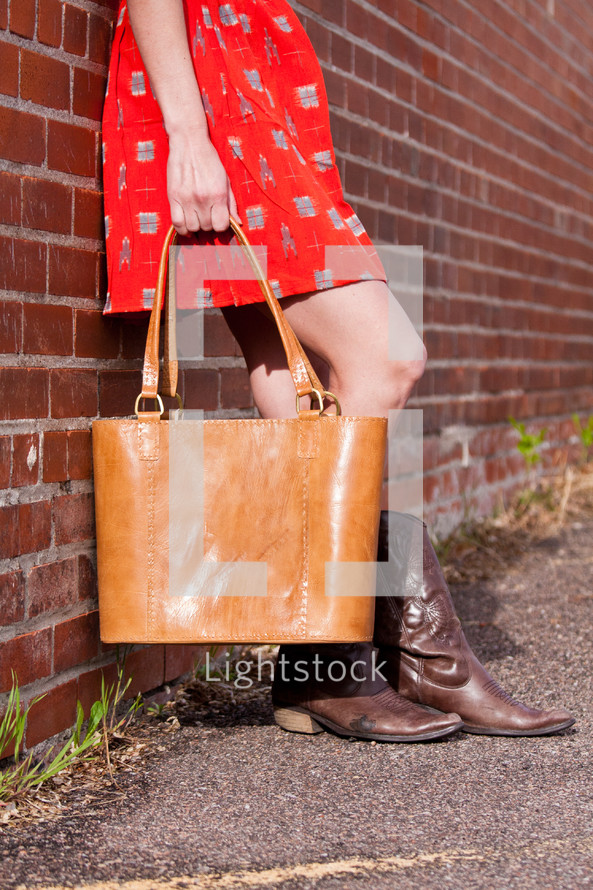 woman holding a large purse