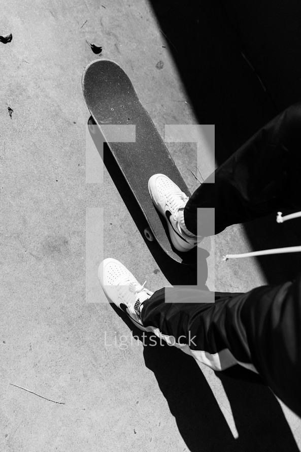 standing on a skateboard