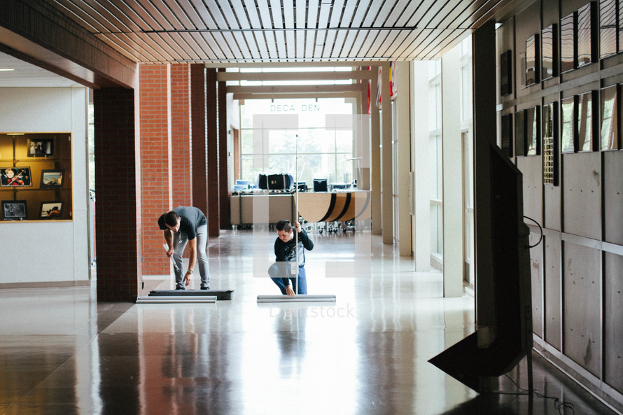 cleanup crew cleaning a lobby