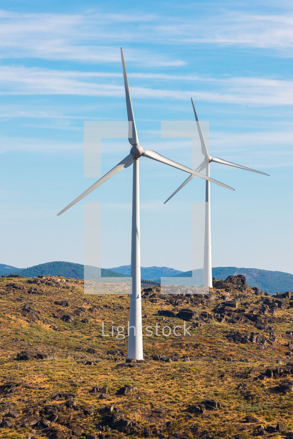 wind turbines at the top of a mountain
