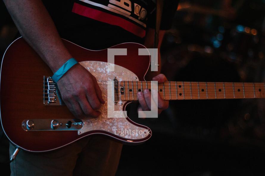a man playing an electric guitar