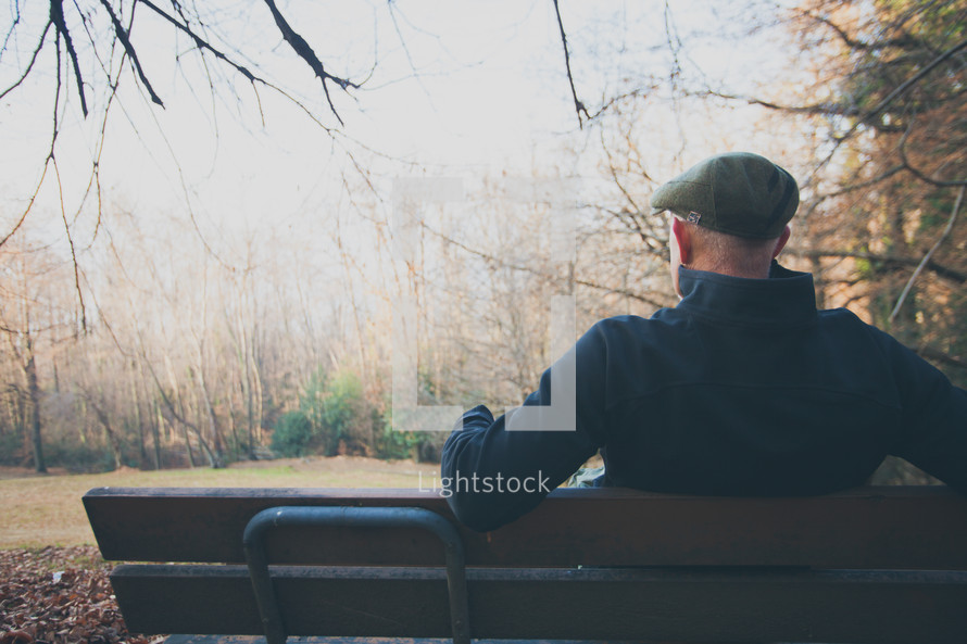 man sitting on a bench relaxing