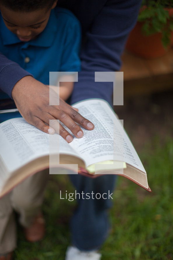 Father and son studying the Bible together.