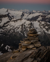 stacked rocks and snow covered peaks