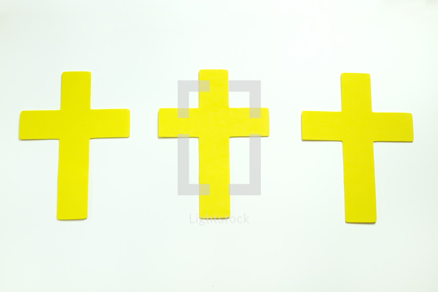 three yellow crosses on white background