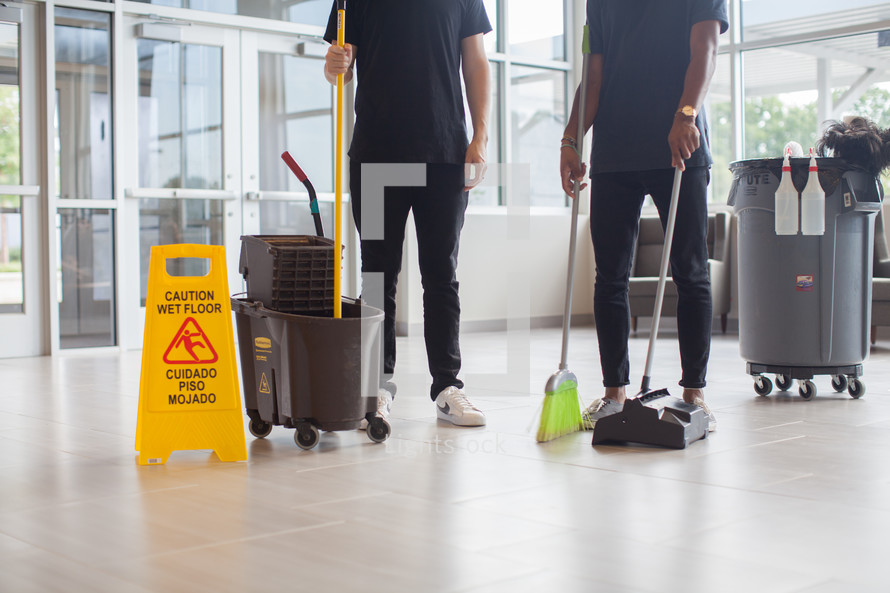 janitors cleaning a church lobby
