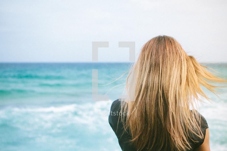 woman's hair blowing in the ocean breeze