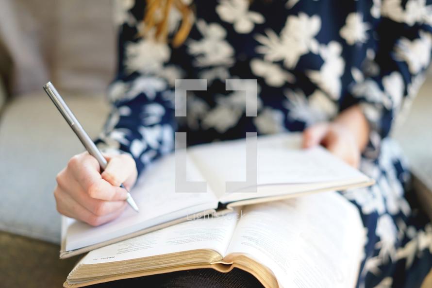 teen girl writing in a notebook