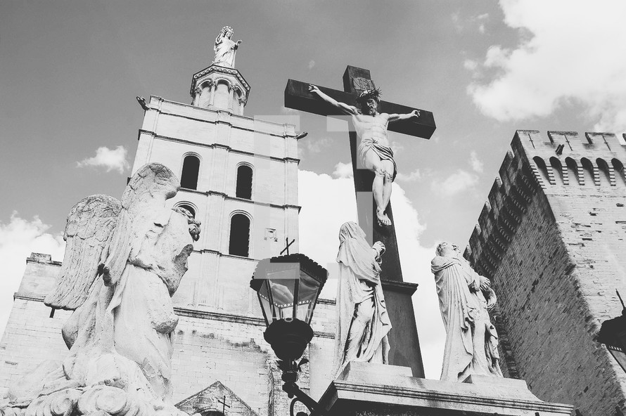 Jesus on the cross in front of a church.
