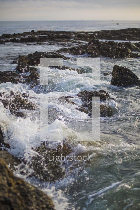 sea rocks and splashing water