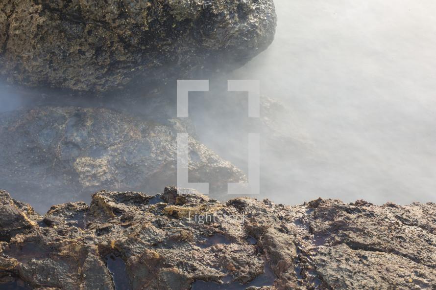mist over sea rocks