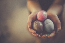 hands full of dyed Easter eggs