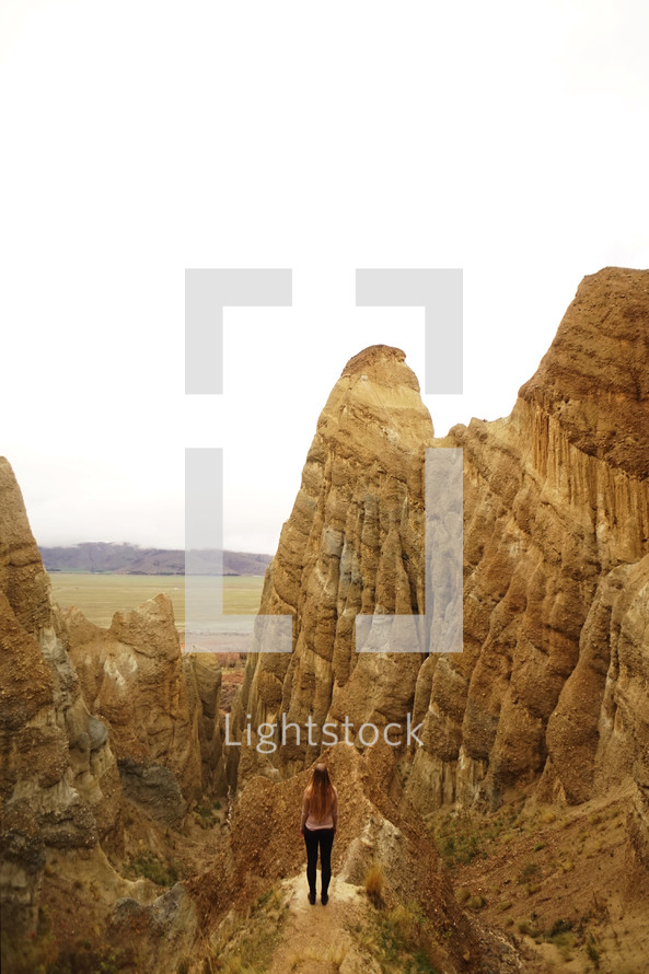 a woman standing on jagged peaks