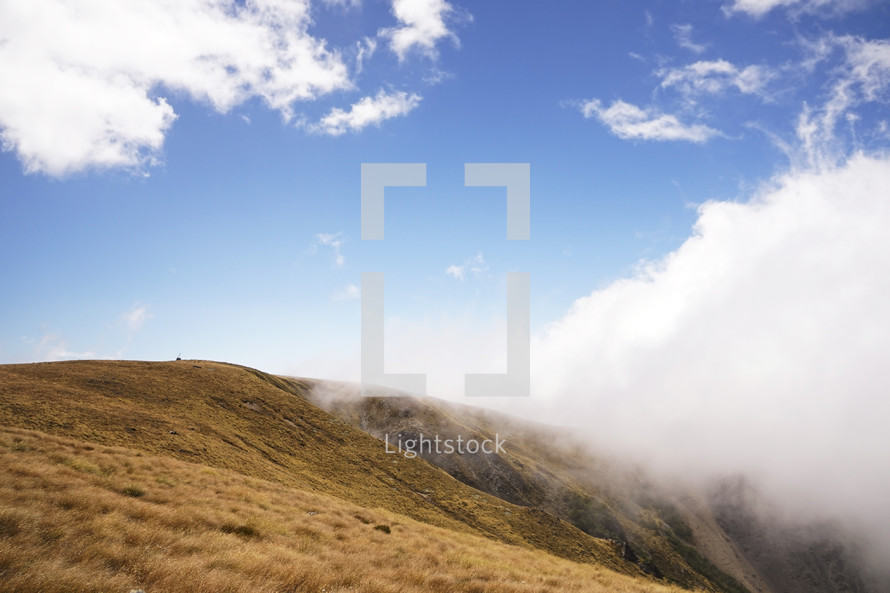 mountaintops in the clouds