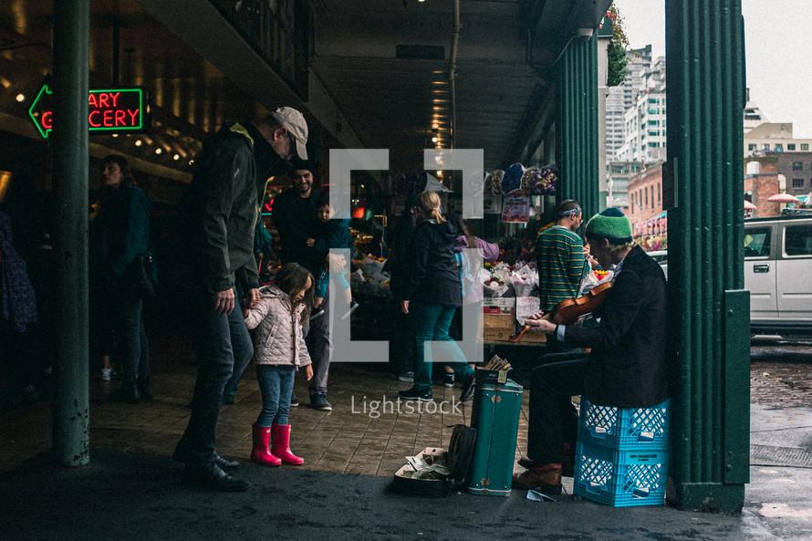 street musician in a market