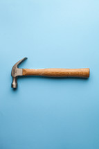 A hammer on a blue background.