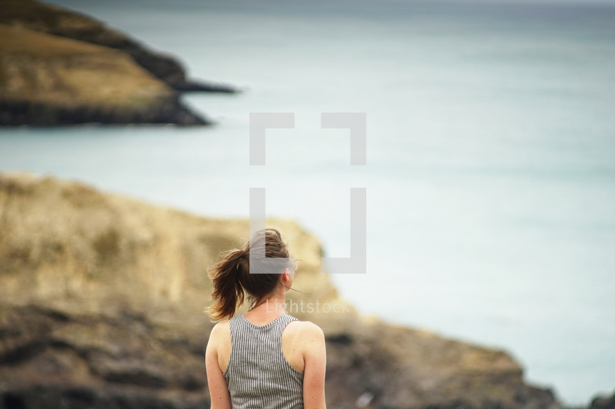 woman standing on a shore