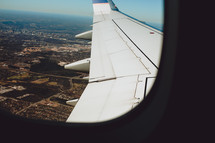 wing of a plane in flight