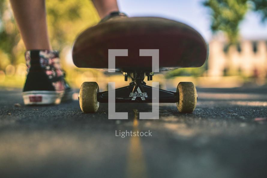 feet of a skateboarder