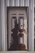 paint peeling on an old door
