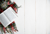 open Bible on a plaid scarf