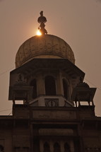 indian temple roof at sunset
