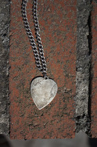 heart necklace on brick