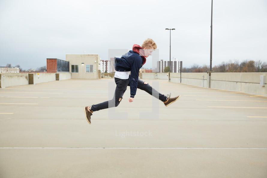 teen boy jumping up