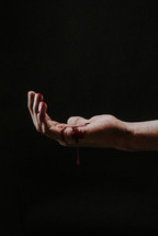 bleeding hand of Christ