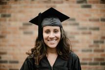 a smiling female graduate