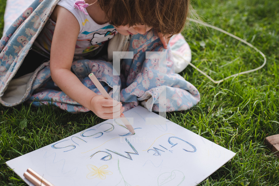 child drawing a give me Jesus sign
