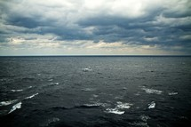 cloudy sky over a churning sea