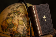 Bible and globe