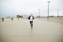 teen boy running in a parking deck