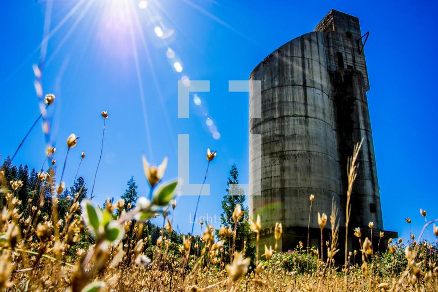 sunlight on a metal silo
