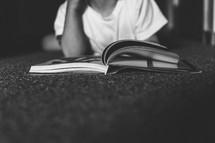 child reading a magazine