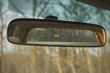 Arrow sign in rear view mirror