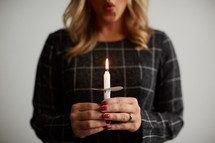 a woman holding a candle