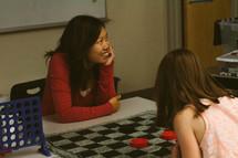 women playing checkers