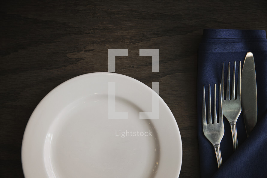 Place setting with empty plate.